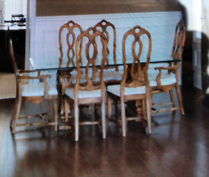 6 chairs and designer table with glass top
