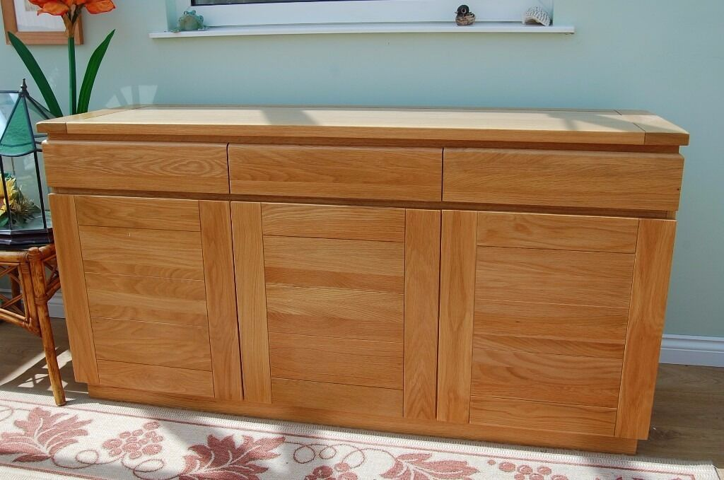 A Multiyork light Oak Table and Chairs as well as a Sideboard. | in ...