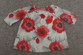 Baby Gap poppy print long sleeved top 3-6 months cream background