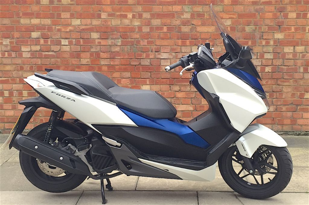 15 reg honda forza 125 abs honda warranty in aldgate. Black Bedroom Furniture Sets. Home Design Ideas