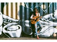 Female guitarist available for paid gigs/lessons in London