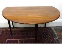 A mid 18th century mahogany dining table