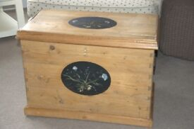Small pine chest with paintings on lid and front