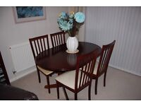 Mahogany Oval Dining Table with 4 Chairs and matching Display Unit