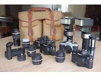 Selection of cameras, lenses and flashes.