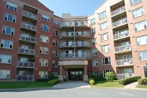 Beautiful, updated 2 bedroom+den with balcony & in-suite laundry