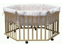 Baby Adjustable Playpen with padded liner.