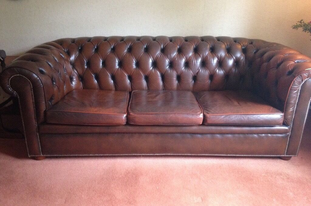 Traditional Brown Leather Sofa. Lexterten. Used. Damage to leather on one  armrest.