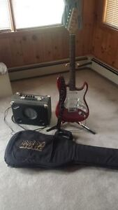 Electric Guitar, Amp, Case, and Stand Package