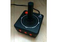 Retro style atari combo games in a joystick