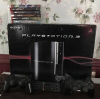Play Station 3 in Box 2 controlers Remote and 6 Games