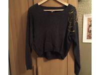 Cropped jumper with shoulder detail