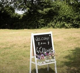 Wedding chalkboard welcome sign flowers jam jars