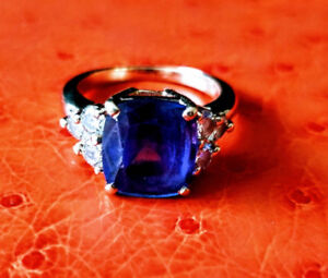 New 6.52 ct tanzanite diamond ring. 14K gold 6.50 gr 7.725CAD