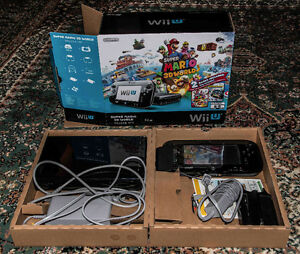 Nintendo Wii U with Mario controller and games