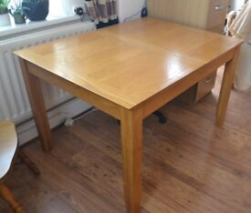 Dining table in warm pine with high polish finish (Extending) seats 6-8