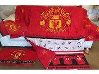 Manchester United bed set, curtains, rug, towel and some wallpaper border.