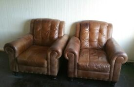 FREE 2 leather arm chairs. Few marks and scuffs but lots of life left in them