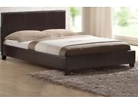 Brown leather double divan bed.