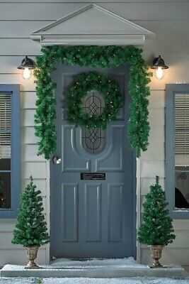 4-piece Pre-lit Outdoor Porch Set Warm White LED Potted Trees, Garland & Wreath