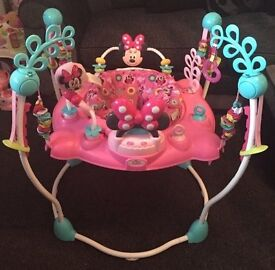 Baby's Pink Disney Minnie Mouse Jumperoo. Rewards jumping with lights, music & sounds