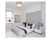 White gloss bed and bedside tabel
