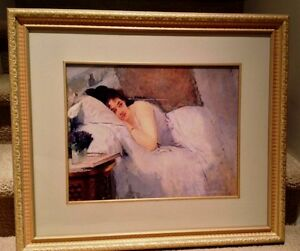 Picture of a lady reclining in bed in a decorative gold frame