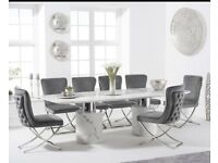 White marble table with 6 grey velvet chairs