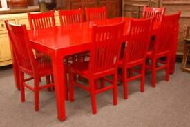 Shocking red solid elm table and eight chairs