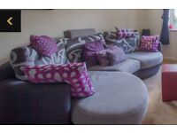 Fama Large Curved Grey and Purple sofa, including matching cushions.