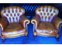 Pair of Golden Tan leather Chesterfield club chairs