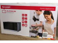Brand new Sharp Microwave oven
