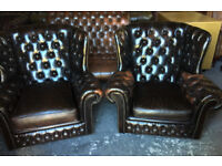 Pair of brown leather Chesterfield armchairs
