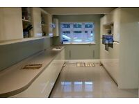 Approx 50 New & Used Alabaster Gloss handleless kitchen cabinet doors and 5m Corian worktop