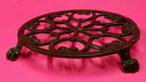 VINTAGE ANTIQUE CAST IRON, ROUND PAW FOOT TRIVET