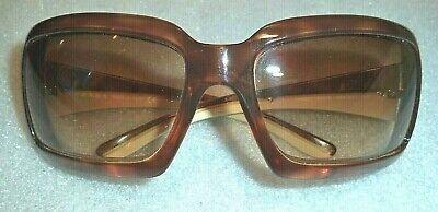 fine women's Prada amber mocha  frame sunglasses