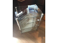 Glass Shelf Unit with four glass shelves , in good condition , solid and quite heavy.