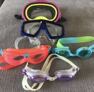 **FIVE PAIRS OF CHILDREN'S SWIM GOGGLES FOR SALE**