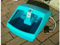 Clairol foot spa, used with water in to massage feet. Has hot and cold settings.