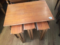 Nest of tables with 3 round smaller tables, Sizes of top table L 24 in D16 in H 21 in