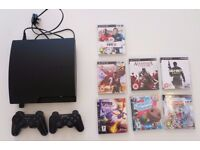 Sony Playstation 3 Slim + 2 controller + 7 games