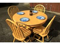 Large round Pine dining table with 4 matching chairs, very good used condition.
