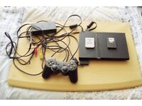 Play Station 2 with 2 controllers and 28 games, plus PS2 memory Card and PS1 Memory Card