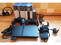 Sony PS2 Mini Slim Console with accessories and games
