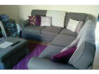 Grey corner couch with foot stool