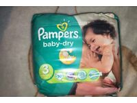 5 unopened packs of pampers