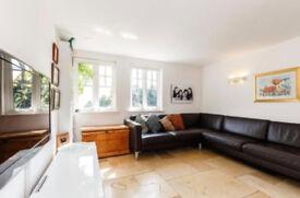 Modern, dark brown, leather corner sofa.