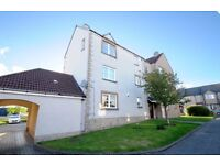 Stunning 2 bedroom top floor flat with private parking and great views over the Forth.
