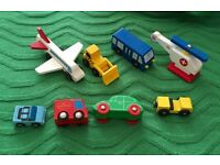 Mixed lot & wooden toy vehicles.brio.aeroplane,helicopter,digger,post van,car,bus.train track,garage