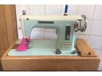 Universal Deluxe Electric sewing machine